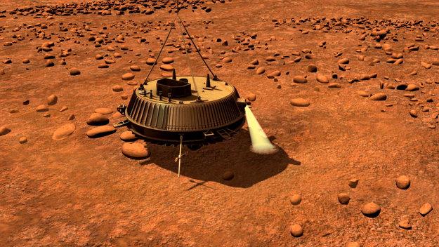 Taiteilijan näkemys Huygens-laskeutujasta Titanin pinnalla. Kuva ESA.